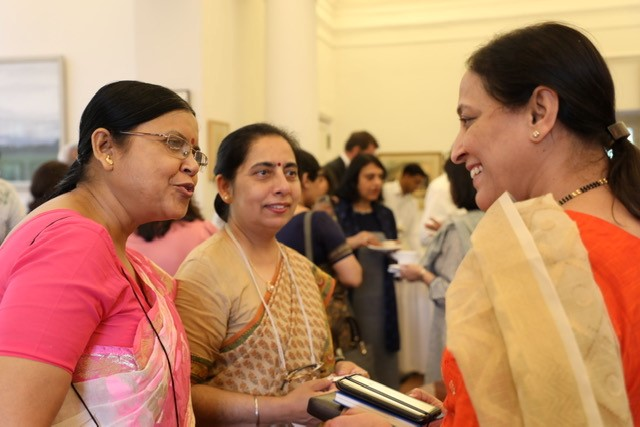 Image of three women talking at event in India