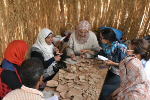 Women examine artefacts as part of cultural heritage Newton Prize project