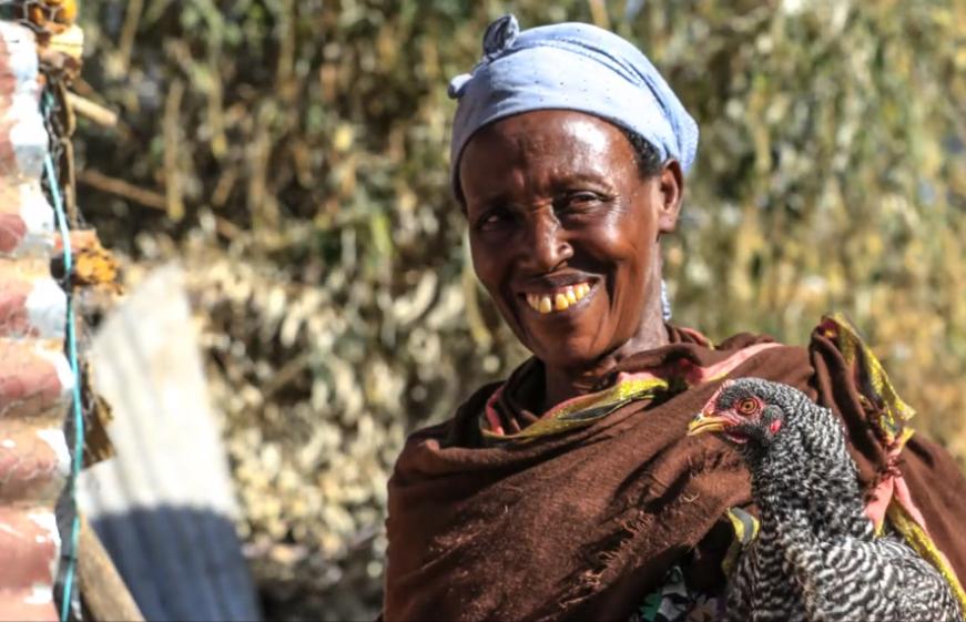 Ethiopian woman farmer with chicken
