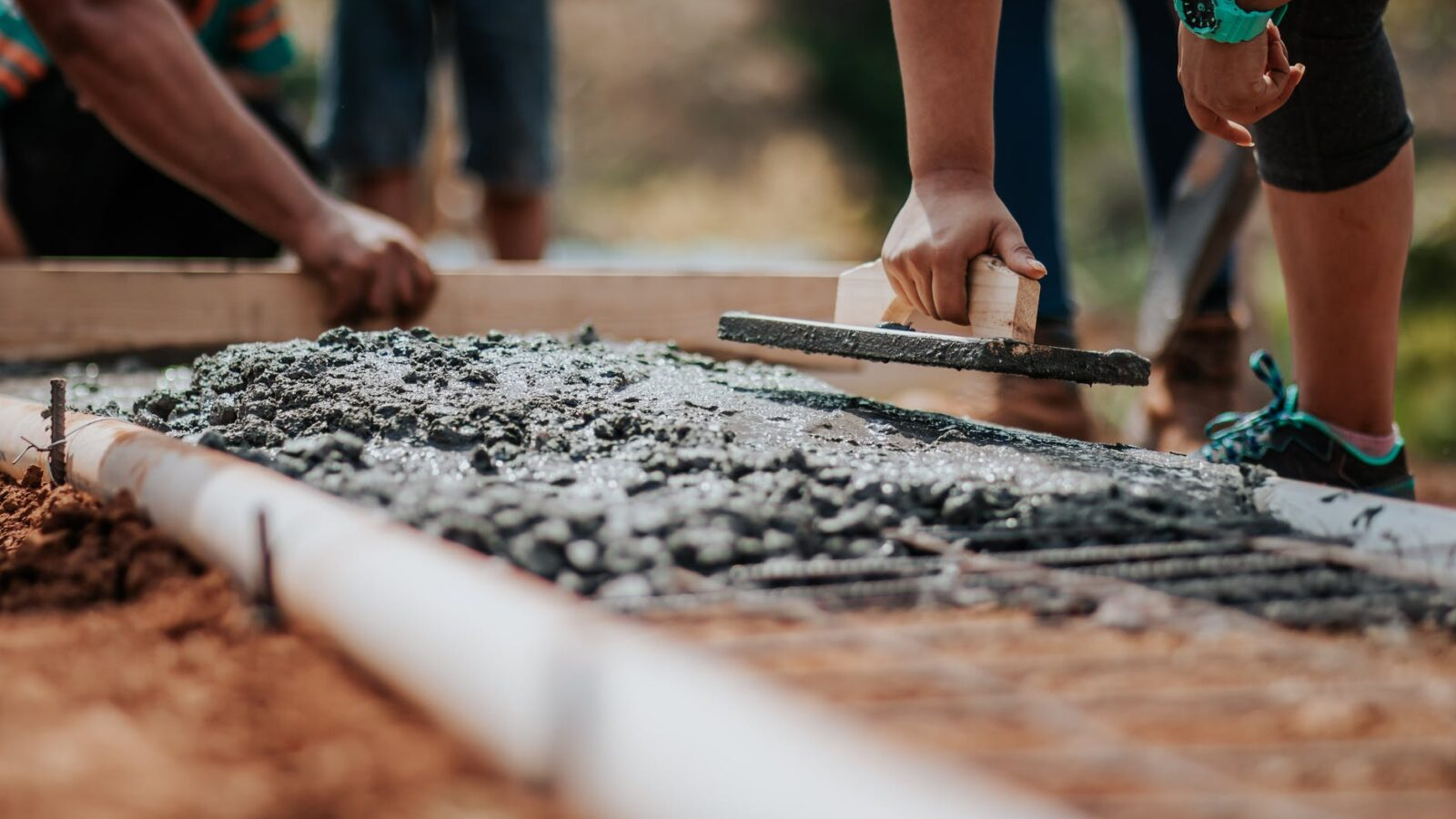 People laying concrete