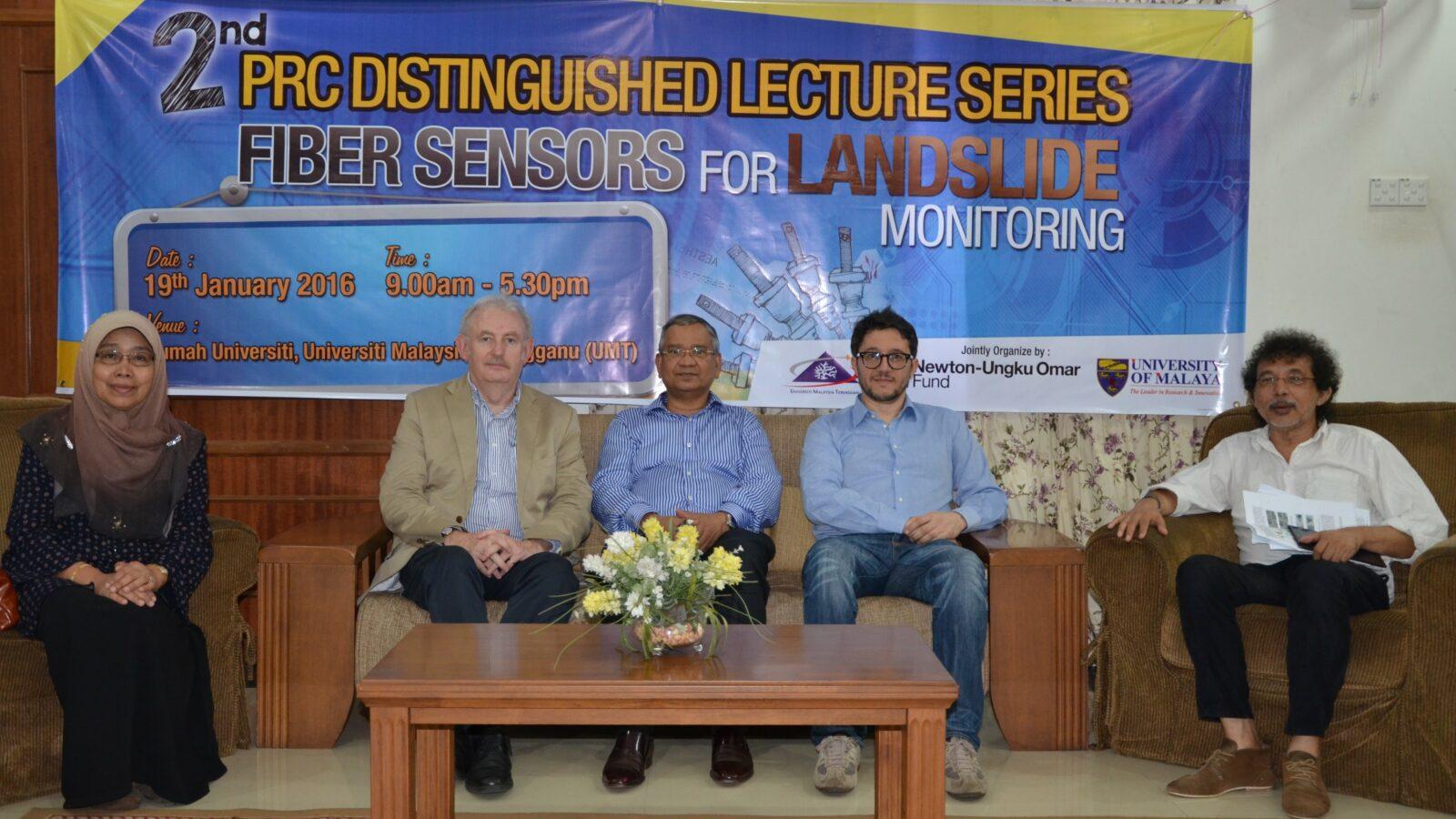 Malaysia landslide team sitting in front of workshop banner