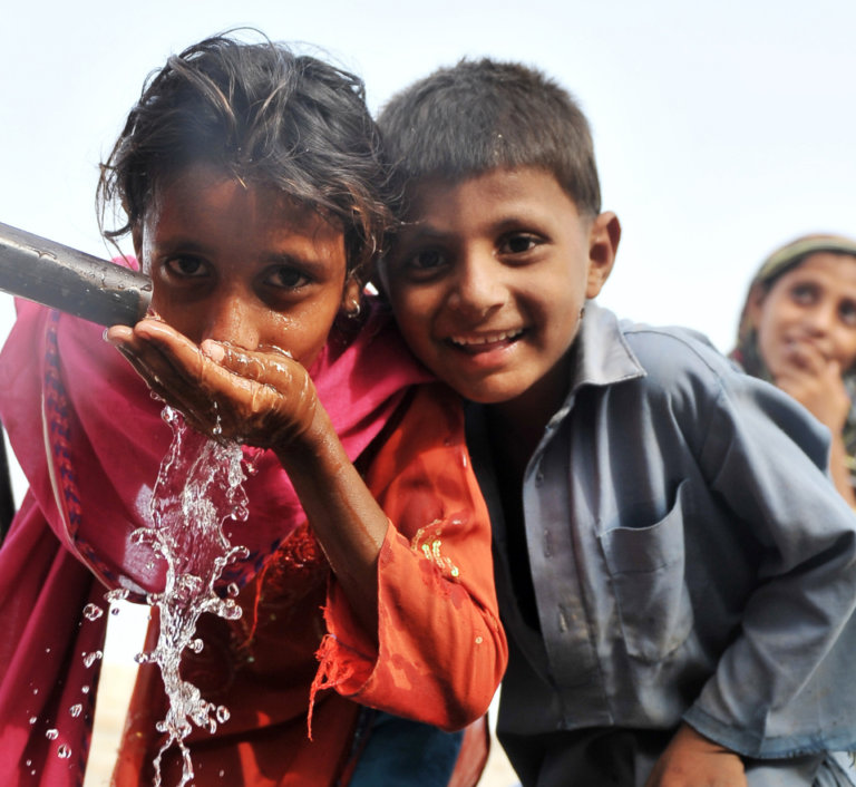 Children drinking from a tap