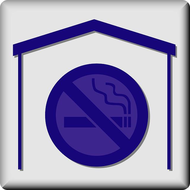 Blue no smoking sign inside outline of house