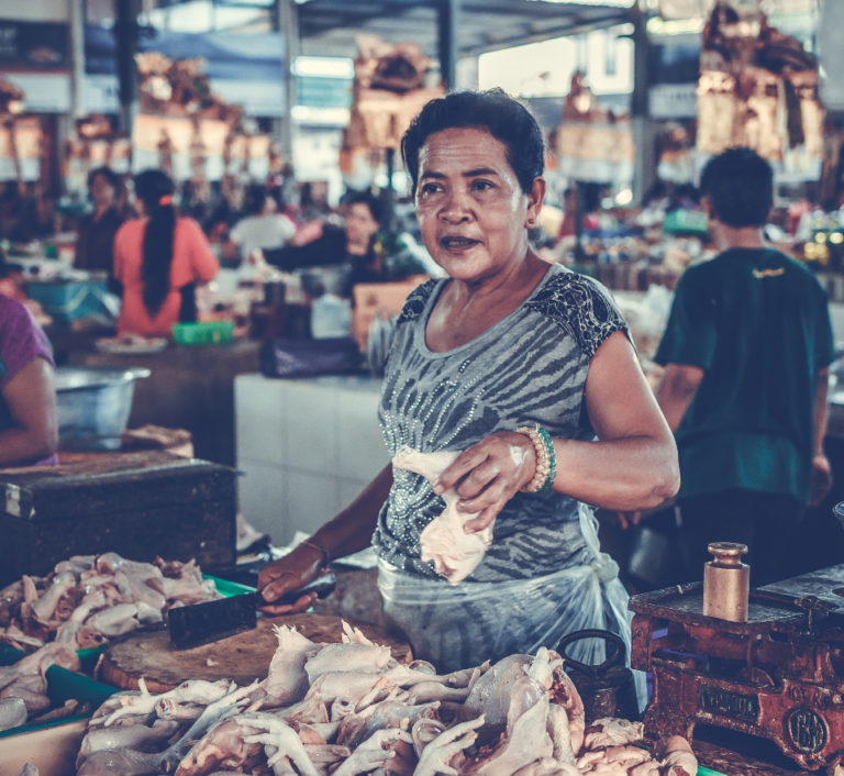 Woman working in food market