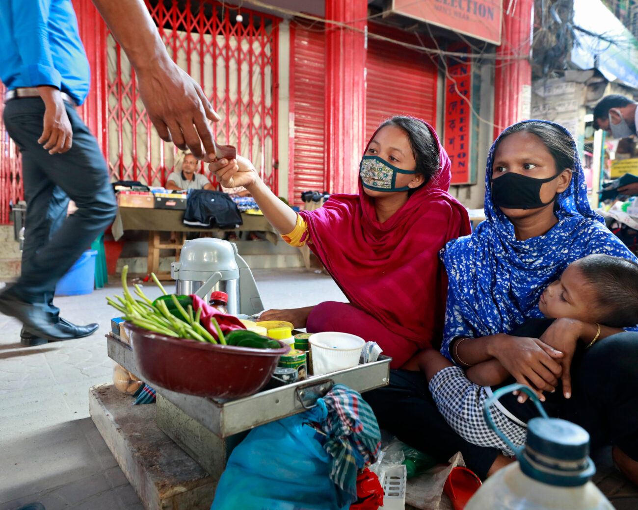 Women in Bangladesh working while caring for their children
